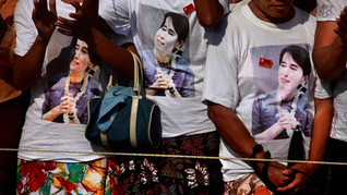 Supporters wearing T-shirts with the photographs of Myanmar's pro-democracy icon Aung San Suu Kyi printed on them, cheer during an election rally addressed by her in Thongwa village some 50 kms from Yangon, Myanmar, 2012.