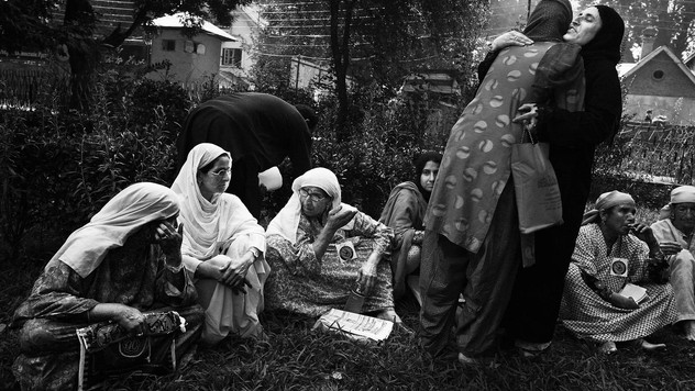 Mughli,  3rd from left, mother of a missing Kashmiri man, speaks to another women as members of Association of Parents of Disappeared Persons (APDP) greet each other during a monthly sit-in protest against involuntary disappearances at a public park in Srinagar, the summer capital of Indian-administered Kashmir, Aug. 30, 2007.