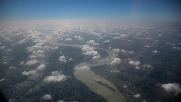 This aerial view shows the river Hooghly, a distributary of the Ganges, as it winds its way towards the Bay of Bengal near Kolkata, in the eastern Indian state of West Bengal, Monday, November 11, 2019. Before it empties into the Bay of Bengal near Sagar island, it passes through Kolkata, the largest city in eastern India. Sagar and many small islands on the edge of the Bay of Bengal which form part of the Sundarbans, the world's largest mangrove ecosystem, have seen a dramatic rise in sea levels due to climate change.