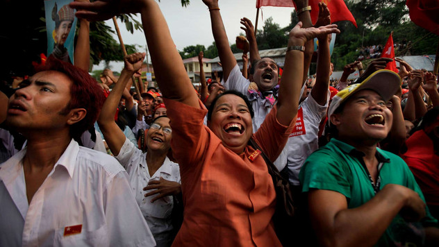 Aung San Suu Kyi's National League for Democracy party supporters cheer upon the party's announcement that Suu Kyi won a parliamentary seat in a landmark election, in Yangon, Myanmar, Sunday, April. 1, 2012.