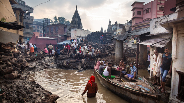 Hindu mourners wait for the cremation of their loved ones at the flooded Manikarnika Ghat, one of the oldest and most sacred places for Hindus to be cremated, on the banks of river Ganges in Varanasi, India, Tuesday, Oct. 22, 2019. As the mighty Ganges River overflows following heavy monsoon rains, large parts of the Hindu holy town of Varanasi were submerged by floodwaters, forcing thousands of cremations to happen on rooftops and narrow alleyways. For millions of Hindus, Varanasi is a place of pilgrimage and anyone who dies in the city or is cremated on its ghats is believed to attain salvation and freed from the cycle of birth and death.