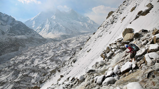 Tourist guide Suresh Panwar navigates icy rocks as he descends a steep mountain ridge in the backdrop of the Bhagirathi peaks and the huge expanse of the Gangotri glacier at an altitude of 4500 meters in the northern Indian state of Uttarakhand, Saturday, May 11, 2019. Bhagirathi peaks feed the Gangotri Glacier which is one of the primary sources of water for the Ganges. This glacier has provided enough water to the arid plains it flows through, even during the driest months. Available data shows that Gangotri Glacier is receding at a frightening pace.