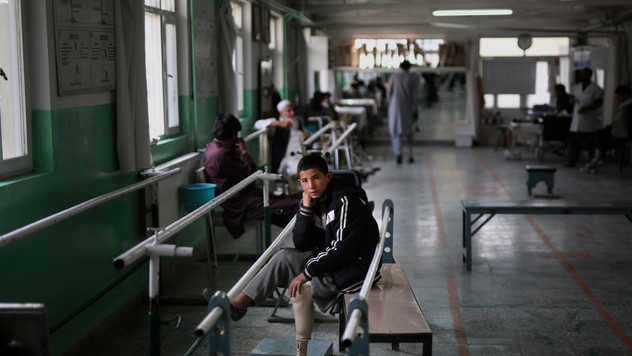 Thirteen year old Abdullah, who lost his left leg when he stepped on an improvised explosive device (IED), takes a break from walking practice with the help of prosthesis, at the International Committee of the Red Cross (ICRC) physical rehabilitation center in Kabul, Afghanistan, Sunday, Dec. 1, 2019.