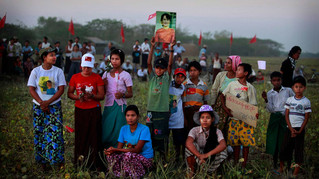 Supporter listen to Myanmar's pro-democracy icon Aung San Suu Kyi, unseen, as she delivers her speech during an election campaign rally in Thongwa village some 50 kms from Yangon, Myanmar, 2012.