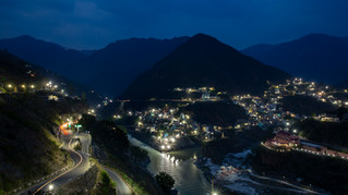 """The confluence of Alaknanda and Bhagirathi rivers, which is officially accepted as the start of the River Ganges, is illuminated at twilight in the town of Devprayag, in the northern Indian state of Uttarakhand, Monday, May 13, 2019. To Hindus, the Ganges is """"Ganga Ma,"""" or Mother Ganges, and millions of Hindus make pilgrimages to the temples and shrines along its shores every year. To drink from it is auspicious. For many Hindus, life is incomplete without bathing in it at least once in their lifetime, washing away their sins."""