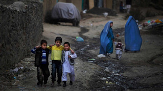 Young Afghan boys walk together in the old part of Kabul, Afghanistan, 2010.