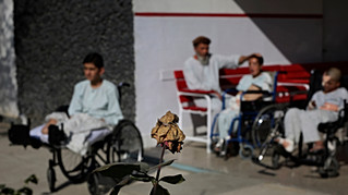 Young Afghan victims of war bask in sun outside their ward at Emergency Surgical Center for Civilian War Victims in Kabul, Afghanistan, Dec. 5, 2019.