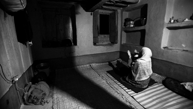Mughli supplicates during her prayers inside her house in Srinagar, the summer capital of Indian-administered Kashmir, Sept. 6, 2007.