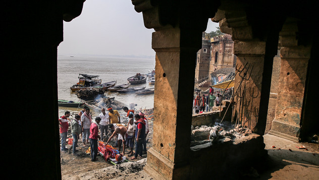 Hindus perform rituals before cremating a body at Manikarnika Ghat, one of the oldest and most sacred place for Hindus to be cremated, on the banks of the river Ganges in Varanasi, India, Friday, Oct. 18, 2019. For millions of Hindus, Varanasi is a place of pilgrimage and anyone who dies in the city or is cremated on its ghats is believed to attain salvation and freed from the cycle of birth and death. Tens of thousands of corpses are cremated in the city each year, leaving half-burnt flesh, dead bodies and ash floating in the Ganges.