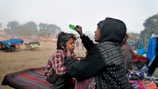 Ruby Khan helps her 7-year-old son Farmaan get ready for school in New Delhi, India.