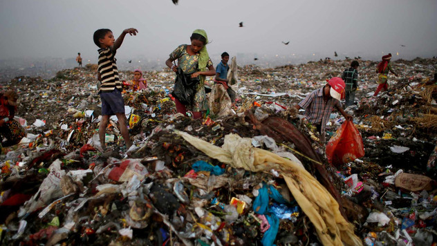 Young Indian waste pickers look for recyclable items at a landfill on the outskirts of New Delhi, India, Oct. 17, 2014 . Rag picking is effectively the primary recycling system in India. While the rag pickers offer invaluable services to the city, they have few rights and are exposed to deadly poisons everyday.