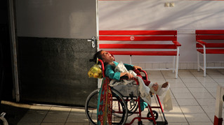 A young Afghan girl, who was wounded in a blast, cries as her relatives left after visiting her at Emergency Surgical Center for Civilian War Victims in Kabul, Afghanistan, Thursday, Dec. 5, 2019.