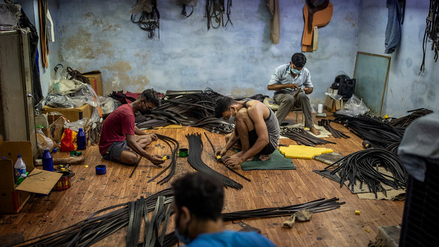 Indian workers wearing face masks, to protect themselves from the coronavirus, work at a leather factory in Kanpur, an industrial city on the banks of the river Ganges, in the northern Indian state of Uttar Pradesh, Wednesday, June 24, 2020. Kanpur city produces an estimated 450 million liters of municipal sewage and industrial effluent daily, much of which flowed directly into the Ganges until recently. Today that number is lower, though it's not clear by how much, after a Ganges cleanup project closed some drains and diverted industrial pollution to treatment plants.