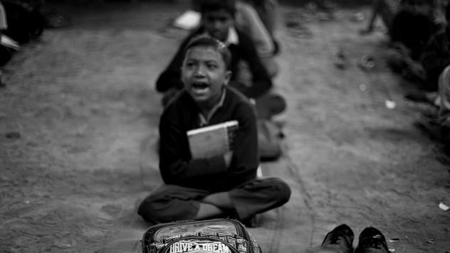Underprivileged Indian children attend a free school run under a metro bridge in New Delhi, India, Tuesday, Nov. 6, 2012.