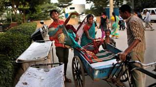 Marjina, 12, is taken to a hospital on a cart used to carry trash.