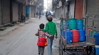 13-year-old Ajmeri, right, walks his younger brother Farmaan to school in New Delhi, India.