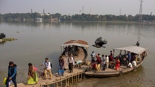 People alight from a boat on the river Hooghly, a distributary of the river Ganges, in Barrackpore, in the eastern Indian state of West Bengal, Thursday, Jan. 16, 2020.