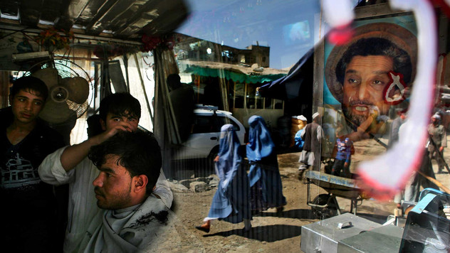 An Afghan barber works on a customer in his shop as the portrait of Afghanistan national hero Ahmad Shah Massoud adores its door in Kabul, Afghanistan, 2009.