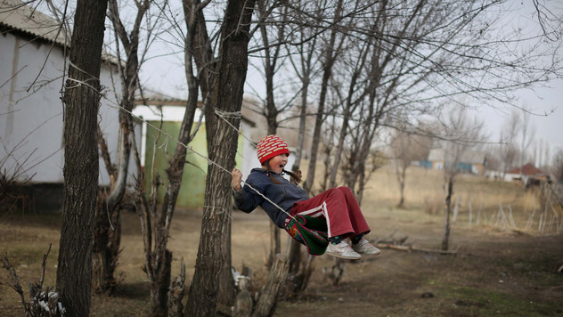 A Kyrgyz girl enjoys a swing.
