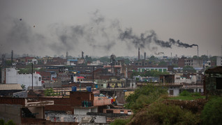 Smoke rises from chimneys of leather tanneries in Kanpur, an industrial city on the banks of the river Ganges, India, Tuesday, June 23, 2020. Kanpur city produces an estimated 450 million liters of municipal sewage and industrial effluent daily, much of which flowed directly into the Ganges until recently. Today that number is lower, though it's not clear by how much, after a Ganges cleanup project closed some drains and diverted industrial pollution to treatment plants.