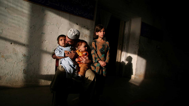 An inmate of Drug Treatment and Rehabilitation Center meet his children after they came to visit him in Kabul.