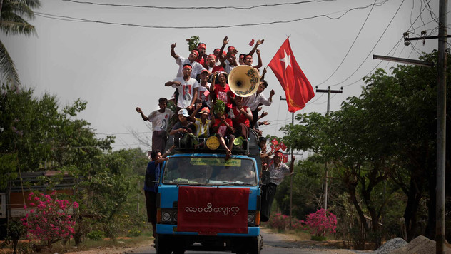 Supporters of Myanmar's pro-democracy leader Aung San Suu Kyi, shout slogans atop a lorry during an election campaign near the village of Wah Thin Kha from where Suu Kyi is standing for by-elections in Myanmar, 2012.