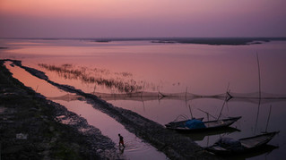 An Indian fisherman wades through shallow waters to reach the banks of the river Ganges after sundown in Bhagalpur in the eastern Indian state of Bihar, Wednesday, Nov. 13, 2019. For more than 1,700 miles, stretching from the Gangotri Glacier in the Himalayas to the Bay of Bengal, the Ganges flows across the plains like a timeline of India's past, nourishing an extraordinary wealth of life. It has seen empires rise and fall. It has seen too many wars, countless kings, British colonials, independence and the rise of Hindu nationalism as a political movement.