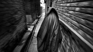 Mughli walks through a narrow lane on her way to the police station in Srinagar, the summer capital of Indian-administered Kashmir, Sept. 7, 2007.