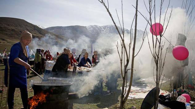 Kyrgyz women cook special meal during Novroz festival near Bishkek.
