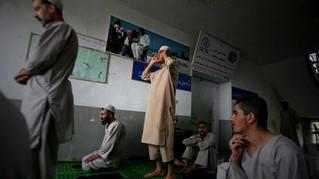 Inmates of Drug Treatment and Rehabilitation Center pray in Kabul.