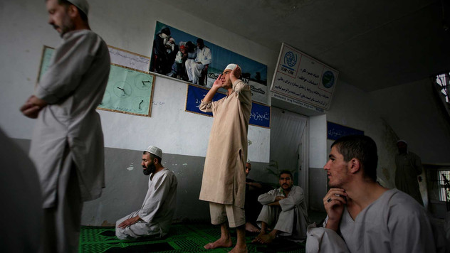 Inmates of Drug Treatment and Rehabilitation Center pray in Kabul.