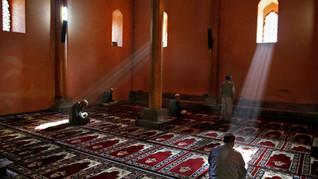 Kashmiri muslims pray inside the Grand Mosque or Jamia Masjid in Srinagar, the summer capital of India-administered Kashmir.