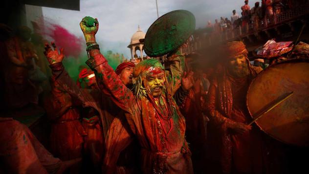 Hindu devotees smeared in colors.