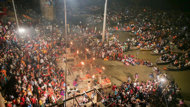 A crowd gathers for a prayer ceremony dedicated to the river Ganges in Varanasi, one of the Hinduism's holiest cities, India, Thursday, Oct. 17, 2019. For millions of Hindus, Varanasi is a place of pilgrimage and anyone who dies in the city or is cremated on its ghats is believed to attain salvation and freed from the cycle of birth and death. Some of the world's largest religious congregations are marked in Varanasi, a city along the River Ganges, also known as one of the oldest continuously inhabited in the world.