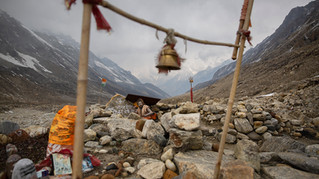 A Hindu holy man meditates near Gaumukh, a snout of the Gangotri Glacier at an altitude of 4000 meters in the northern Indian state of Uttarakhand, Saturday, May 11, 2019. Gaumukh, which literally means head of a cow, is rapidly moving backward as Gangotri Glacier has receded considerably for the last few centuries. Research has shown that Gaumukh has retreated around three kilometers in two centuries. The Gangotri glacier is one of the main sources of the River Ganges.