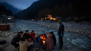 Hindu pilgrims perform rituals on the banks of the Bhagirathi river, one of the two headstreams of the river Ganges, in Gangotri, in the northern Indian state of Uttarakhand, Saturday, May 11, 2019. Gangotri, at an altitude of 3042m, is a major pilgrimage site associated with the river Ganges.