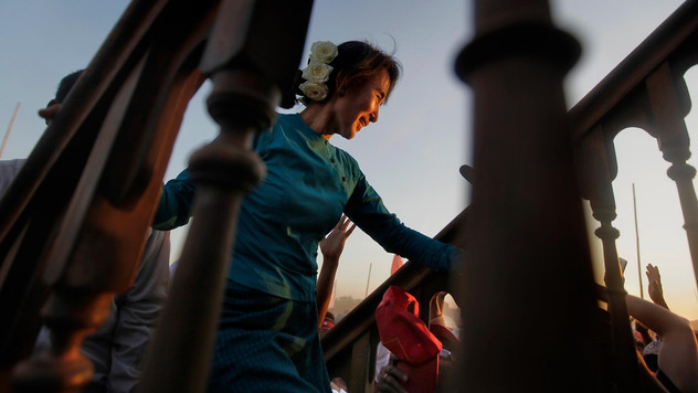 Myanmar's pro-democracy icon Aung San Suu Kyi, ascends the stairs towards the stage for delivering her speech during an election campaign rally in Thongwa village some 50 kms from Yangon, Myanmar, 2012.
