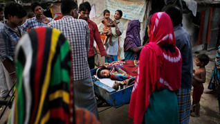 Marjina, 12, is taken to a hospital on a cart used to carry trash, outside their rented shanty on the outskirts of New Delhi, India.