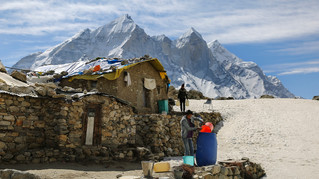 Indian boys who work as porters for trekkers and Hindu pilgrims store ice in a plastic container outside an isolated Ashram in the backdrop of the Bhagirathi peaks, as seen from Tapovan, at an altitude of 4500 meters in the northern Indian state of Uttarakhand, Friday, May 10, 2019. Bhagirathi peaks feed the Gangotri Glacier which is one of the primary sources of water for the river Ganges. This glacier has provided enough water to the arid plains it flows through, even during the driest months. Available data shows that Gangotri Glacier is receding at a frightening pace.