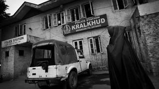 Mughli walks outside a police station in Srinagar, the summer capital of Indian-administered Kashmir, Sept. 7, 2007.