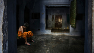 An elderly Hindu woman sits in solitude inside an ashram meant for those who come to die and attain salvation in Varanasi, one of Hinduism's holiest cities on the banks of river Ganges, in the northern Indian state of Uttar Pradesh, Friday, Oct. 18, 2019. For millions of Hindus, Varanasi is a place of pilgrimage and anyone who dies in the city or is cremated on its ghats is believed to attain salvation and freed from the cycle of birth and death. This has, for ages, motivated devout Hindus to make the pilgrimage to Varanasi in their final days.