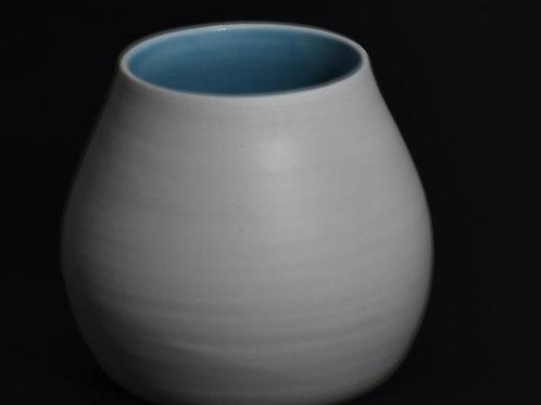 Porcelain vase turquoise - unglazed polished exterior