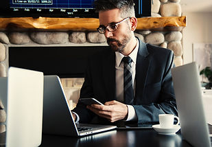 man in suit working on laptop 07JUL.jpg
