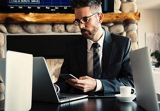 man in suit working on laptop 07JUL.jpg