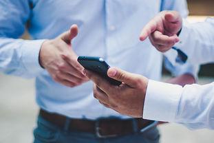 two businessmen on phone.jpg