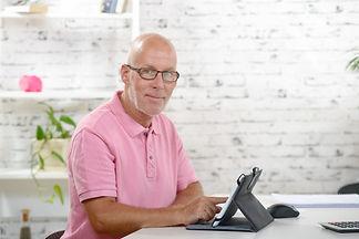 older man with tablet.jpg