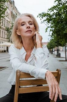 woman seated on chair on street.jpeg