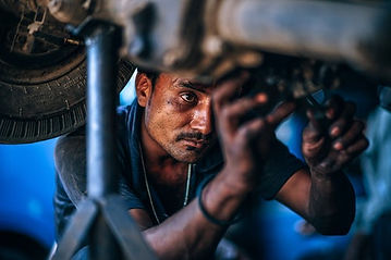 man repairing vehicle.jpg