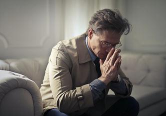 Older businessman contemplating.jpg