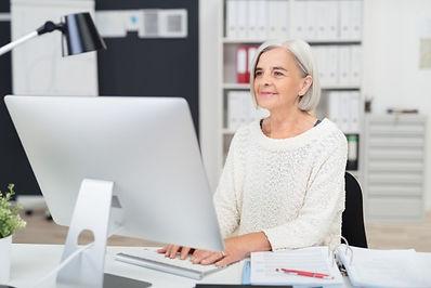 senior-older-elderly-woman-PC-Mac-office